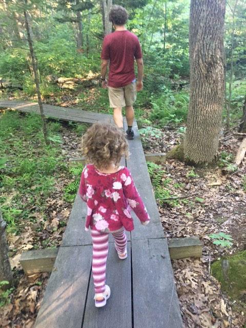 child walking in woods
