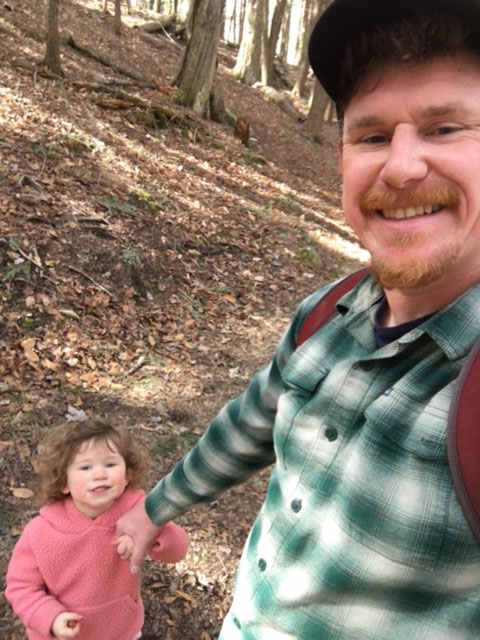 Todd and his daughter hiking