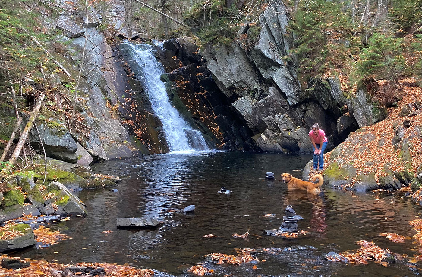 Cold Stream Falls waterfall with woman and dog in water