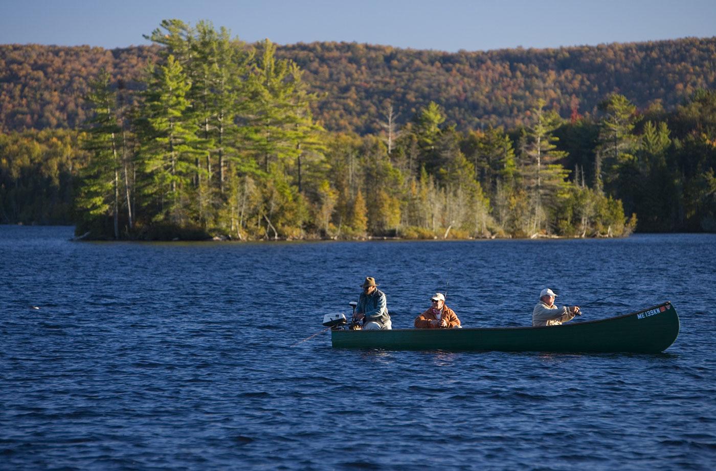 men in boat fishing on Moosehead Lake